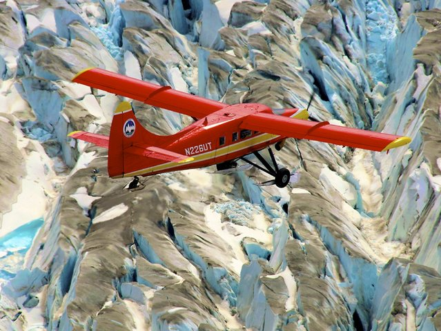 NASA's DHC-3 Otter plane flies in Operation IceBridge-Alaska surveys of mountain glaciers in Alaska in this image released on September 18, 2014. Over the past few decades, average global temperatures have been on the rise, and this warming is happening two to three times faster in the Arctic. (Photo by Chris Larsen/Reuters/NASA/University of Alaska-Fairbanks)