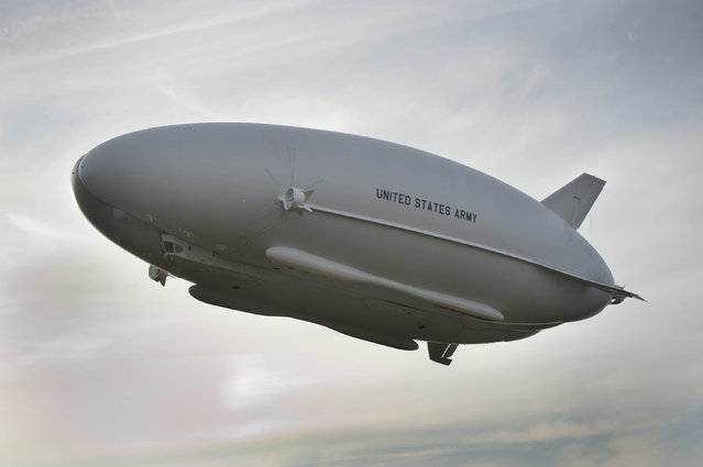 The Long Endurance Multi-Intelligence Vehicle (LEMV) is pictured above Joint Base McGuire-Dix-Lakehurst, New Jersey during its first flight, August 7, 2012. The LEMV, like a blimp, is said to be capable of carrying multiple intelligence, surveillance and reconnaissance payloads for more than 21 days at altitudes greater than 22,000 feet. (Photo by Reuters/U.S. Army Space and Missile Defense Command/Army Forces Strategic Command)