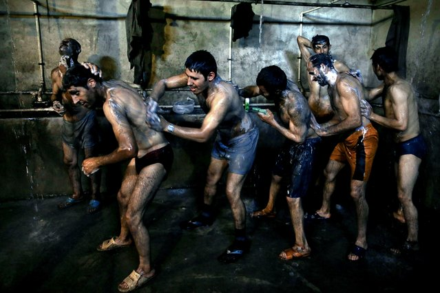 In this Tuesday, May 6, 2014 photo, Iranian coal miners shower after a long day of work at a mine on a mountain in Mazandaran province, near the city of Zirab, 212 kilometers (132 miles) northeast of the capital Tehran, Iran. (Photo by Ebrahim Noroozi/AP Photo)