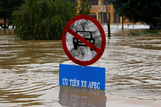 A traffic sing indicating APEC summit vehicles priority is seen along submerged street in UNESCO heritage ancient town of Hoi An after typhoon Damrey hits Vietnam on November 6, 2017. (Photo by Reuters/Kham)