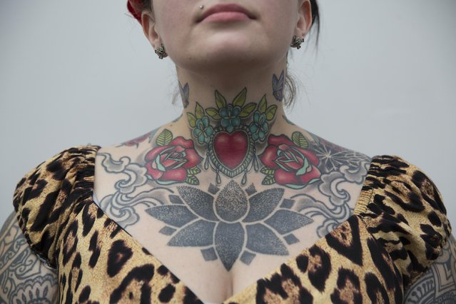Nic Smith poses to show her body art during the 10th International Tattoo Convention in London September 27, 2014. (Photo by Neil Hall/Reuters)