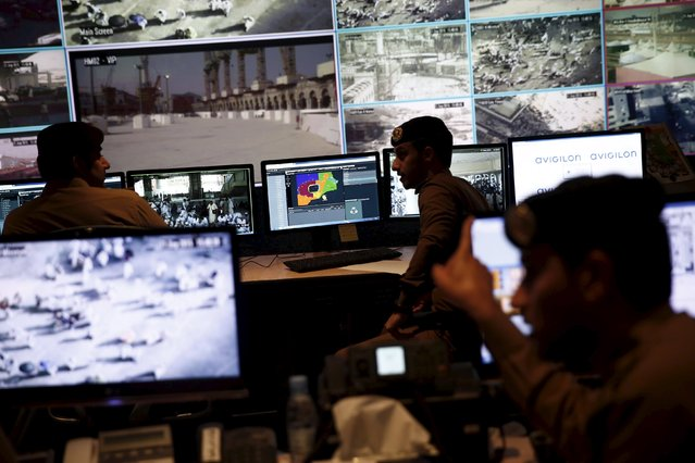 Saudi policemen watch monitor screens showing footage from cameras set up around the holy places, in the holy city of Mecca, September 21, 2015. (Photo by Ahmad Masood/Reuters)