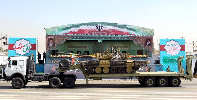 A military truck carrying a tank drives past pictures of Iran's Supreme Leader Ayatollah Ali Khamenei (R) and late leader Ayatollah Ruhollah Khomeini during a parade marking the anniversary of the Iran-Iraq war (1980-88), in Tehran September 22, 2015. (Photo by Raheb Homavandi/Reuters/TIMA)