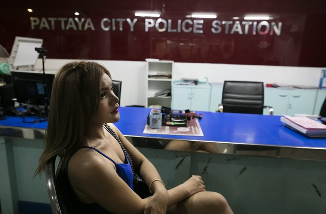 A prostitute sits inside a police station after being arrested July 30, 2016 in Pattaya, Thailand. (Photo by Paula Bronstein/Getty Images)