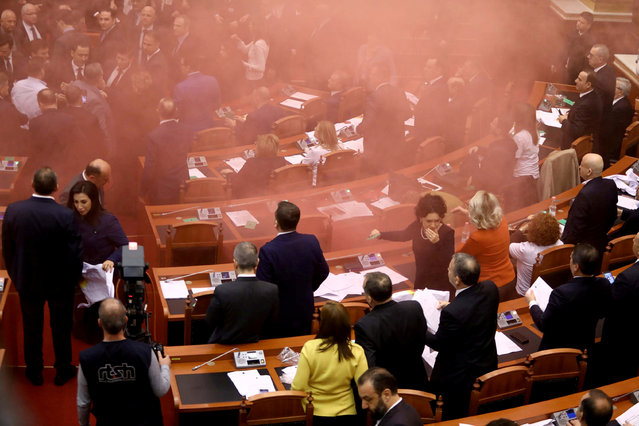 Albania's opposition lawmakers throw smoke bombs inside the Parliament during the election of the new prosecutor, in Albanian Parliament in Tirana, Albania December 18, 2017. (Photo by Reuters/Stringer)