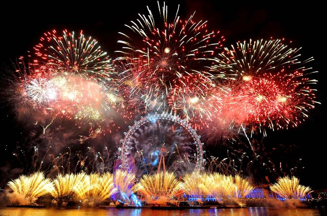 Fireworks explode over the London Eye during New Year celebrations. (Photo by Dominic Lipinski/Press Association)