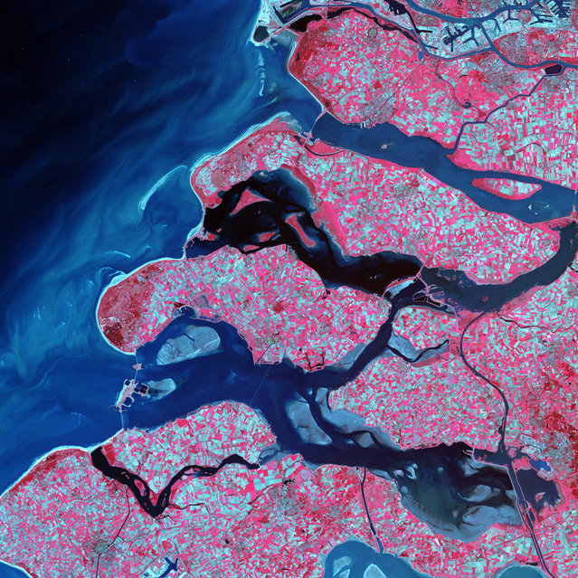 Delta Region, Netherlands. Along the southern coast of the Netherlands, sediment-laden rivers have created a massive delta of islands and waterways in the gaps between coastal dunes. After unusually severe spring tides devastated this region in 1953, the Dutch built an elaborate system of dikes, canals, dams, bridges, and locks to hold back the North Sea. Image taken on September 24, 2002, by the ASTER instrument aboard NASA's Terra satellite. (Photo by NASA/GSFC/USGS EROS Data Center)