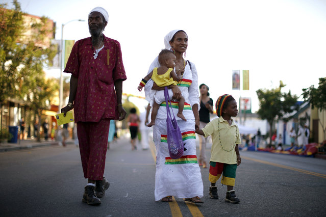 Najara Apraku, 28, holds her 11-month-old son, Selassi Ra Shabaka, as she walks with her husband, Jamaiel Shabaka, and son, Kwame Negast Shabaka, in the Little Ethiopia area of Los Angeles, California September 14, 2014. (Photo by Lucy Nicholson/Reuters)