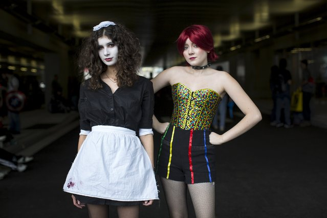 Olivia Alicandri dressed as Magenta and Olivia Viteznik dressed as Columbia, both characters from Rocky Horror Picture Show, pose for photos on day two of New York Comic Con in Manhattan, New York, October 9, 2015. (Photo by Andrew Kelly/Reuters)