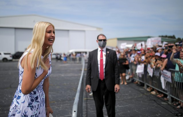 White House senior advisor Ivanka Trump reacts to the crowd gathered to greet U.S. President Donald Trump on the tarmac as he arrives by helicopter at Asheville Regional Airport in Asheville, North Carolina, U.S., August 24, 2020. (Photo by Carlos Barria/Reuters)