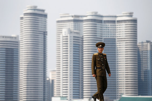 A soldier walks on the bank of the river in central Pyongyang, North Korea on April 16, 2017. (Photo by Damir Sagolj/Reuters)
