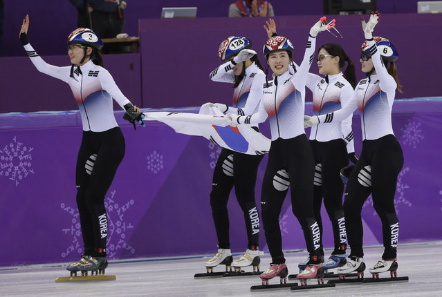 South Korea celebrate after their women's 3000 meters short track speedskating relay A final in the Gangneung Ice Arena at the 2018 Winter Olympics in Gangneung, South Korea, Tuesday, February 20, 2018. (Photo by David J. Phillip/AP Photo)