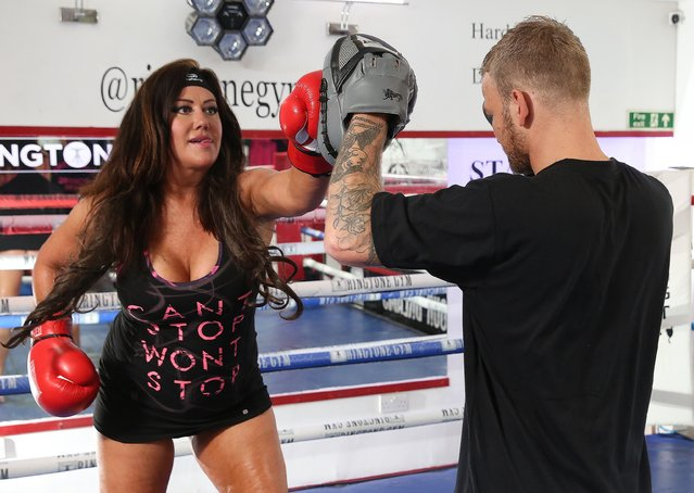 "New lovebirds boxer Robin Deakin – once known as ""Britain's Worst Boxer"" – and former UK ""Big Brother"" star Lisa Appleton go to the boxing gym in London, United Kingdom on September 28, 2016. The pair were seen holding hands in the street on arrival, and they then slogged it out in the ring and fooled about in Robin's gym. (Photo by FameFlynet UK)"