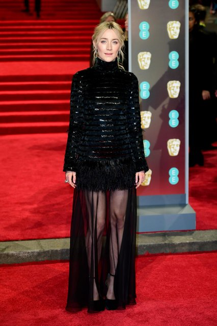 US- Irish actress Saoirse Ronan poses on the red carpet upon arrival at the BAFTA British Academy Film Awards at the Royal Albert Hall in London on February 18, 2018. (Photo by PA Wire)