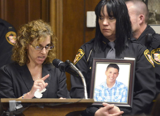 Dina Parmertor, mother of victim Daniel, speaks during the sentencing of T.J. Lane Tuesday, March 19, 2013, in Chardon, Ohio. Lane, was given three lifetime prison sentences without the possibility of parole Tuesday for opening fire last year in a high school cafeteria in a rampage that left three students dead and three others wounded. Lane, 18, had pleaded guilty last month to shooting at students in February 2012 at Chardon High School, east of Cleveland.  (Photo by Duncan Scott/AP Photo/The News-Herald/Pool)
