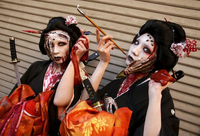 Participants in costume pose for a picture after a Halloween parade in Kawasaki, south of Tokyo, October 25, 2015. (Photo by Yuya Shino/Reuters)