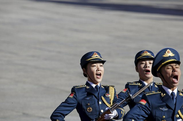 Air force soldiers march during a welcoming ceremony for Germany's Chancellor Angela Merkel outside the Great Hall of the People in Beijing, China, October 29, 2015. (Photo by Jason Lee/Reuters)