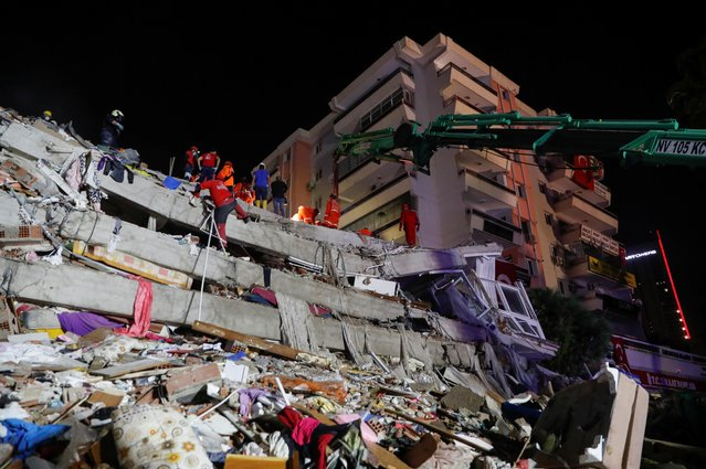 Rescue operations take place on a site after an earthquake struck the Aegean Sea, in the coastal province of Izmir, Turkey, October 30, 2020. (Photo by Murad Sezer/Reuters)