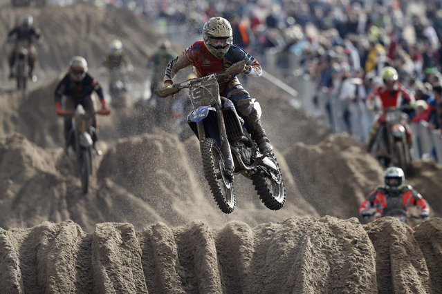 Riders negotiate a dune as they compete in the Adult Solo race at the HydroGarden Weston Beach Race in Weston- super- Mare, south west England, on October 9, 2016. (Photo by Adrian Dennis/AFP Photo)