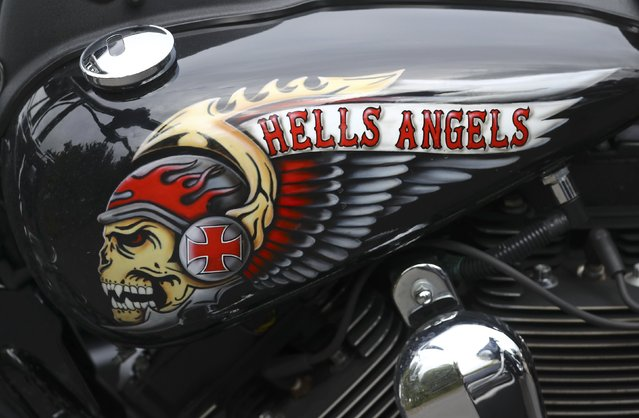 A decorated tank of a Harley Davidson motorbike is pictured at the funeral of Aygun Mucuk, shot president of the Giessen chapter of the Hells Angels in Giessen, Germany, October 12, 2016. (Photo by Kai Pfaffenbach/Reuters)