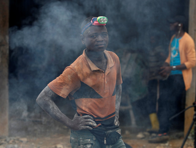 A miner stands at Makala gold mine camp near the town of Mongbwalu in Ituri province, eastern Democratic Republic of Congo on April 7, 2018. (Photo by Goran Tomasevic/Reuters)