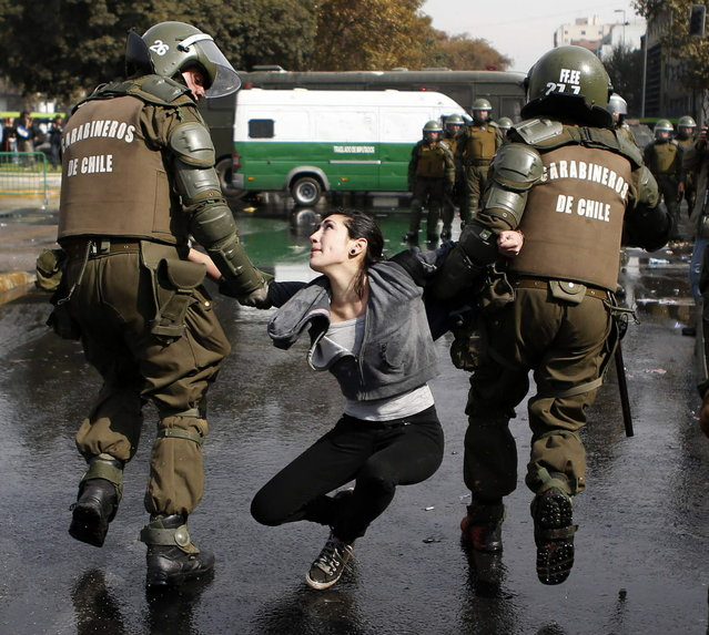 A demonstrator is detained during May Day rallies in Santiago May 1, 2013. (Photo by Ivan Alvarado/Reuters)