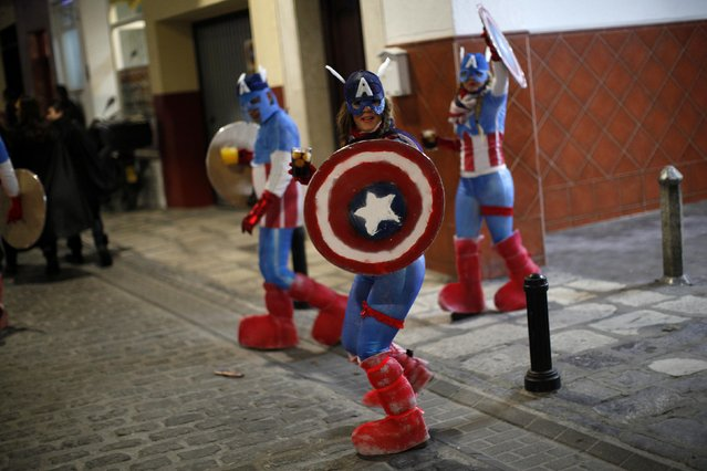 Revellers dressed up as Captain America take part in New Year's celebrations in Coin, near Malaga, southern Spain, early January 1, 2015. (Photo by Jon Nazca/Reuters)
