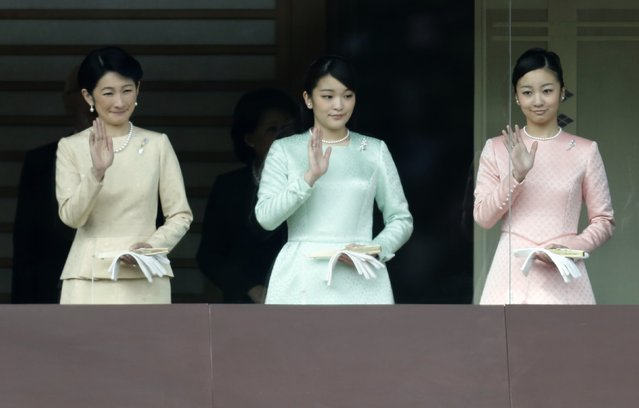Japan's Princess Kiko (L), Princess Mako (C), and Princess Kako wave to well-wishers during a public appearance for New Year celebrations at the Imperial Palace in Tokyo January 2, 2015. (Photo by Yuya Shino/Reuters)