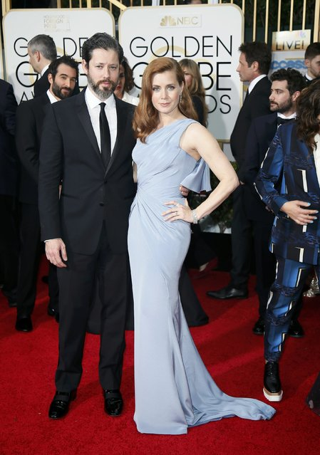 Actress Amy Adams and artist Darren Le Gallo arrive at the 72nd Golden Globe Awards in Beverly Hills, California January 11, 2015. (Photo by Danny Moloshok/Reuters)