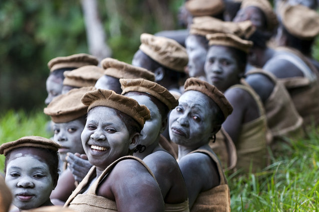 """Merit Winner: """"The Tata Honda sect"""". The photographer could get inside of an enclosed sect named Tatahonda in the Democratic Republic of the Congo. The ladies are preparing for their religious ceremony. (Photo and caption by Gergely Lantai-Csont/National Geographic Traveler Photo Contest)"""