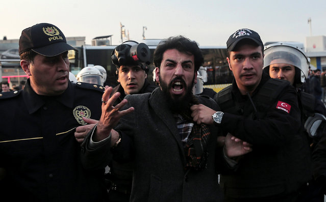 Police officers detain a protester during a protest against the arrest of pro-Kurdish Peoples' Democratic Party (HDP) lawmakers, in Istanbul, Turkey November 6, 2016. (Photo by Huseyin Aldemir/Reuters)