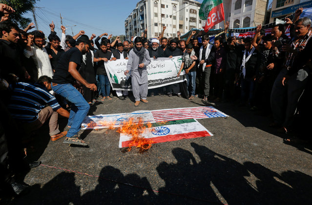 Supporters of Imamia Students Organization (ISO) burn the U.S., Israeli and Indian flags in a protest during the religious procession ahead of Ashura in Karachi, Pakistan, October 11, 2016. (Photo by Akhtar Soomro/Reuters)