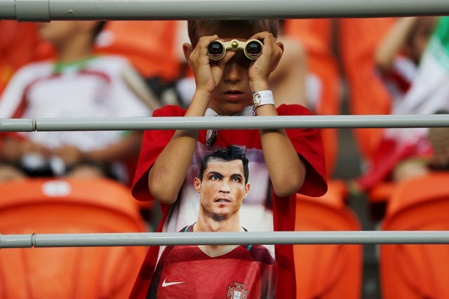 Portugal fan wearing a shirt of Portugal's Cristiano Ronaldo inside the stadium before the Russia 2018 World Cup Group B football match between Iran and Portugal at the Mordovia Arena in Saransk on June 25, 2018. (Photo by Ivan Alvarado/Reuters)