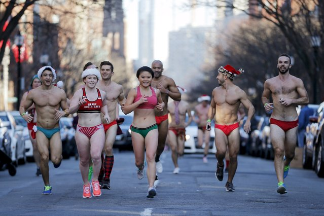 Participants run through the streets of the Back Bay during the 16th annual Santa Speedo Run in Boston, Massachusetts, December 12, 2015. (Photo by Brian Snyder/Reuters)