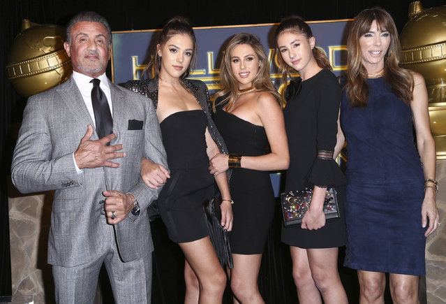 Sylvester Stallone, left, and Jennifer Flavin, right, pose with their daughters Sistine Stallone, from second left, Sophia Stallone and Scarlet Stallone after they are announced as the 2017 Miss Golden Globes at the HFPA and InStyle celebration for the 2017 Golden Globe awards season at Catch LA on Thursday, November 10, 2016, in West Hollywood, Calif. (Photo by John Salangsang/Invision/AP Photo)