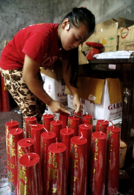 An Indonesian worker prepares candles at a traditional Chinese candle maker for the upcoming Lunar New Year in Bogor, Indonesia, 27 January  2015. (Photo by Adi Weda/EPA)