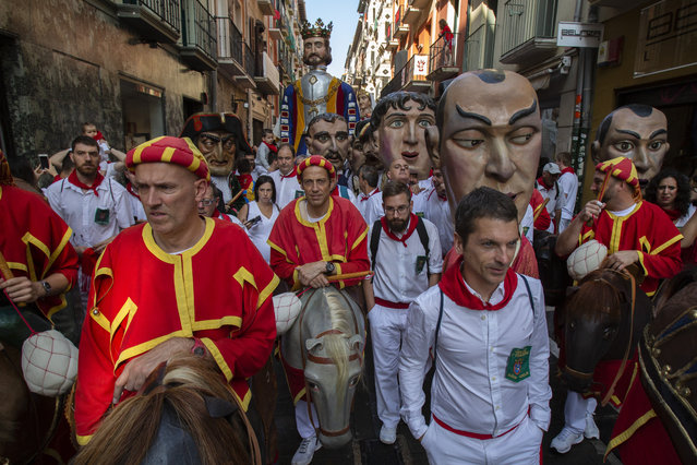 Kilikis, big heads amid revellers take part in the Comparsa de Gigantes y Cabezudos, or Giants and Big Heads parade on the second day of the San Fermin Running of the Bulls festival on July 7, 2018 in Pamplona, Spain. (Photo by Pablo Blazquez Dominguez/Getty Images)