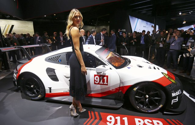 Tennis star Maria Sharapova poses with a Porsche 911 RSR race car at the 2016 Los Angeles Auto Show in Los Angeles, California, U.S November 16, 2016. (Photo by Mike Blake/Reuters)