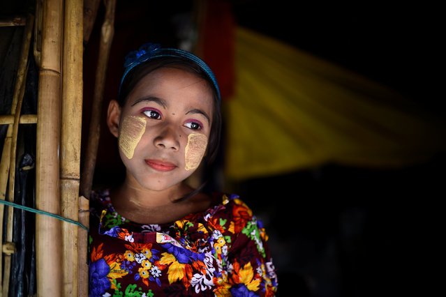 A Rohingya refugee girl named Romzida, aged 8, poses for a photograph as she wears thanaka paste at Shamlapur camp in Cox's Bazaar, Bangladesh, March 30, 2018. (Photo by Clodagh Kilcoyne/Reuters)