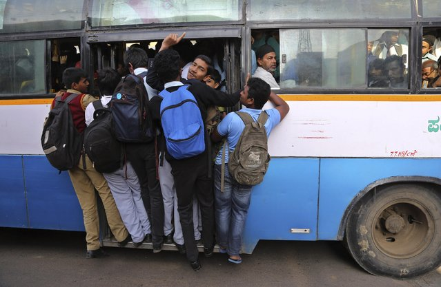 Indian students travel in a crowded bus during the morning rush hour in Bangalore, India, Wednesday, February 4, 2015. India's Right To Education Act promises free, compulsory schooling to all children ages 6 to 14, but millions of children still don't go to school and many who do are getting only the barest of educations. (Photo by AP Photo)