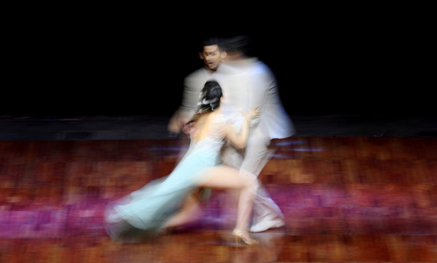 Juan Pablo Bulich and Rocio Garcia Liendo, representing the city of Buenos Aires, perform during the Stage style final round at the Tango World Championship in Buenos Aires, Argentina on August 23, 2018. (Photo by Marcos Brindicci/Reuters)