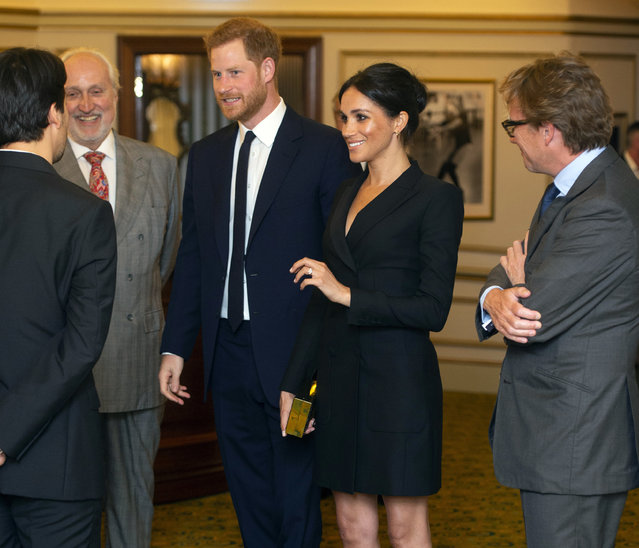 Britain's Prince Harry and Meghan, Duchess of Sussex Victoria Palace Theatre before attending a gala performance of the musical Hamilton, in support of the charity Sentebale, in London, Wednesday, August 29 2018. The evening will raise awareness and funds for Sentebale's work with children and young people affected by HIV in southern Africa. (Photo by Dan Charity/Pool Photo via AP Photo)