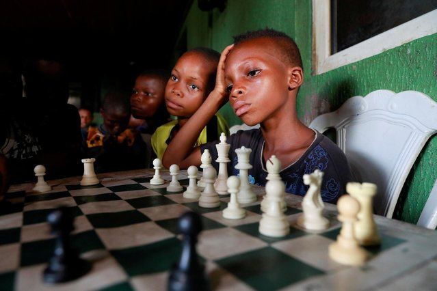 Children play chess at a community palace in Makoko, Lagos, Nigeria on May 5, 2021. (Photo by Temilade Adelaja/Reuters)