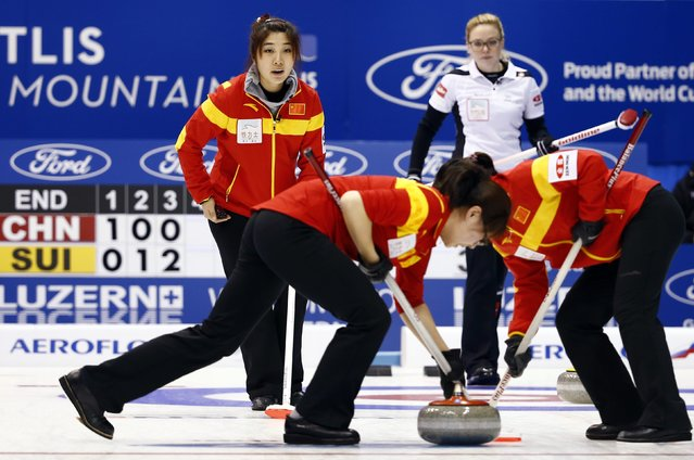 China's skip Sija Liu (back L) instructs her team-mates Jinli Lui (front on L) and Yinlun Jiang as Switzerland's skip Alina Paetz (back R) watches during their curling round robin game at the World Women's Curling Championship in Sapporo March 16, 2015. (Photo by Thomas Peter/Reuters)