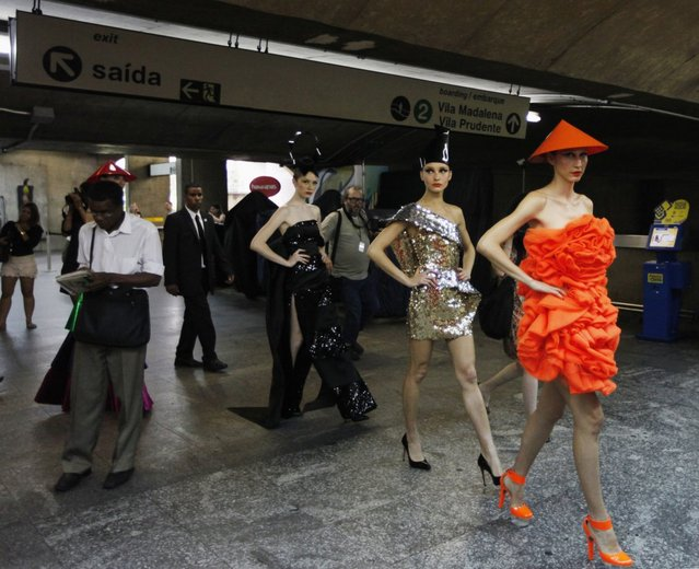 Models present creations in a subway station during Sao Paulo Fashion Week in Sao Paulo October 27, 2013. (Photo by Paulo Whitaker/Reuters)