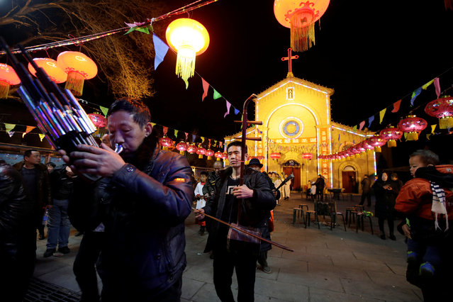 Villagers attend a praying ceremony on the Christmas Eve at a Catholic church on the outskirts of Taiyuan, North China's Shanxi province, December 24, 2016. (Photo by Jason Lee/Reuters)