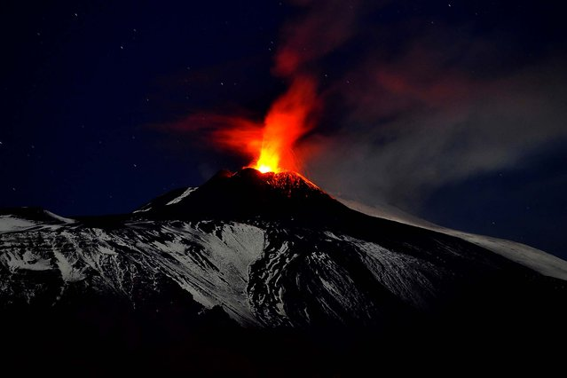 Mt. Etna spews lava during an eruption, seen from Acireale, near the Sicilian town of Catania on November 16, 2013. (Photo by Carmelo Imbesi/Associated Press)
