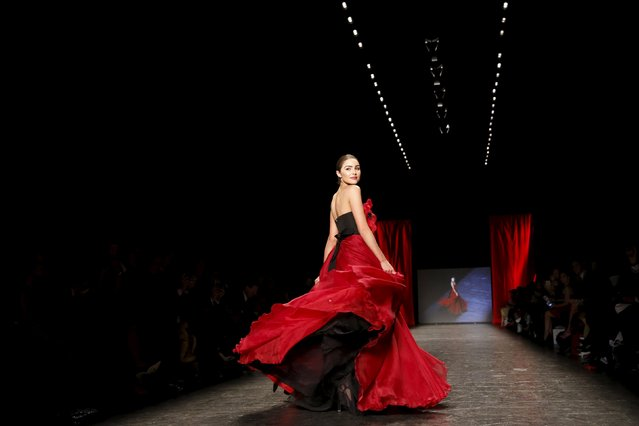 Olivia Culpo presents a creation during the American Heart Association's (AHA) Go Red For Women Red Dress Collection, presented by Macy's at New York Fashion Week February 11, 2016. (Photo by Andrew Kelly/Reuters)