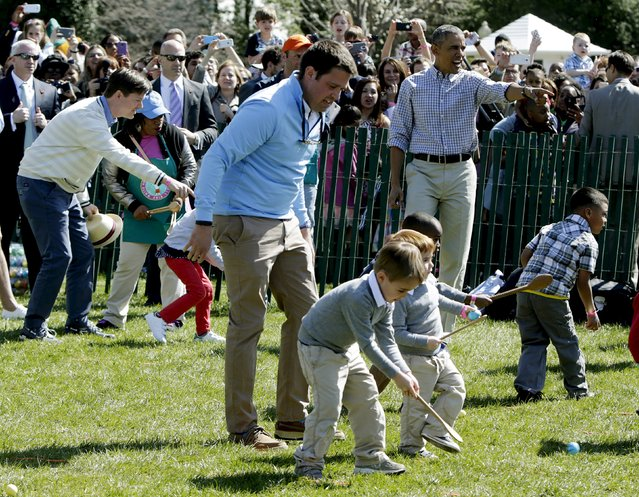 U.S. President Barack Obama (R) directs the first race at the annual White House Easter Egg Roll in Washington April 6, 2015. (Photo by Gary Cameron/Reuters)