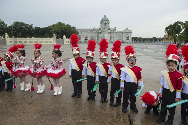 Children in colorful uniforms gather for a memorial ceremony for late King Chulalongkorn at Royal Plaza in Bangkok on October 23, 2018. The national memorial day marks the anniversary of King Chulalongkorn passing away, who died on October 23, 1910 after ruling Siam – as Thailand was known then – for 42 years. (Photo by Romeo Gacad/AFP Photo)